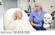 Купить «Professional cosmetologist preparing to perform procedures in modern cosmetology office», видеоролик № 30818399, снято 12 апреля 2019 г. (c) Яков Филимонов / Фотобанк Лори