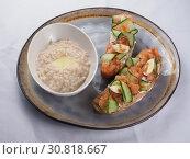 Купить «Oatmeal with butter and bruschetta with salmon», фото № 30818667, снято 27 марта 2019 г. (c) Алексей Кокорин / Фотобанк Лори