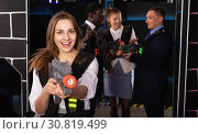 Купить «Woman playing lasertag with co-workers», фото № 30819499, снято 4 апреля 2019 г. (c) Яков Филимонов / Фотобанк Лори