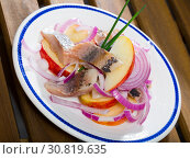 Купить «Fried potatoes with slices of mild-cured herring and onions on plate», фото № 30819635, снято 18 июля 2019 г. (c) Яков Филимонов / Фотобанк Лори