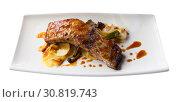 Купить «Baked under sauce tasty pork ribs at plate with mushrooms», фото № 30819743, снято 16 июня 2019 г. (c) Яков Филимонов / Фотобанк Лори