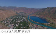 Купить «Город Нурек, плотина, водохранилище. Вид с дрона. Таджикистан», видеоролик № 30819959, снято 3 июня 2016 г. (c) kinocopter / Фотобанк Лори