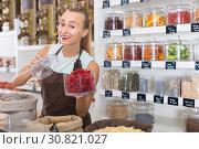 Купить «Girl seller is demonstraiting Flower of Hibiscus», фото № 30821027, снято 4 сентября 2017 г. (c) Яков Филимонов / Фотобанк Лори