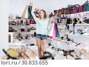 Купить «Woman 20-23 years old is walking with purchases around the store.», фото № 30833655, снято 17 августа 2017 г. (c) Яков Филимонов / Фотобанк Лори
