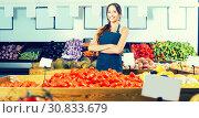 Купить «Adult female seller wearing apron», фото № 30833679, снято 18 июля 2019 г. (c) Яков Филимонов / Фотобанк Лори