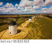 Купить «Aerial view of Route of Don Quixote with windmills in Consuegra», фото № 30833923, снято 23 апреля 2019 г. (c) Яков Филимонов / Фотобанк Лори