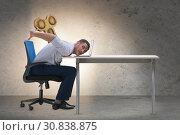 Купить «Employee losing energy from too much work», фото № 30838875, снято 16 июля 2019 г. (c) Elnur / Фотобанк Лори