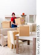 Купить «Young male contractor with boxes working indoors», фото № 30839515, снято 1 февраля 2019 г. (c) Elnur / Фотобанк Лори