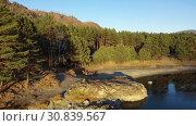 Купить «Altai natural landscape. Flight on drone over the Altai Katun river in the evening time.», видеоролик № 30839567, снято 11 мая 2019 г. (c) Serg Zastavkin / Фотобанк Лори