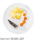 Купить «Top view of steamed hake with potatoes and carrot», фото № 30841207, снято 17 июля 2019 г. (c) Яков Филимонов / Фотобанк Лори