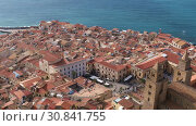 Купить «Panoramic view of the central part of the Sicilian town of Cefalu. Cefalu is one of the major tourist attractions in the Sicily region, Italy», видеоролик № 30841755, снято 29 мая 2019 г. (c) Алексей Кузнецов / Фотобанк Лори