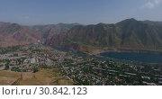 Купить «Город Нурек, плотина, водохранилище. Вид с дрона. Таджикистан», видеоролик № 30842123, снято 3 июня 2016 г. (c) kinocopter / Фотобанк Лори