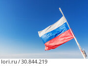 Купить «Russian tricolor develops in a clear sky», фото № 30844219, снято 25 мая 2019 г. (c) Дмитрий Тищенко / Фотобанк Лори
