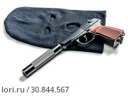 Купить «black balaclava and a pistol with a silencer close up on a white table», фото № 30844567, снято 1 октября 2016 г. (c) Константин Лабунский / Фотобанк Лори
