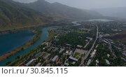 Купить «Город Нурек, плотина, водохранилище. Вид с дрона. Таджикистан», видеоролик № 30845115, снято 3 июня 2016 г. (c) kinocopter / Фотобанк Лори