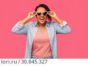 Купить «african american woman in heart-shaped sunglasses», фото № 30845327, снято 2 марта 2019 г. (c) Syda Productions / Фотобанк Лори