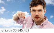 Купить «angry young man ready for fist punch over sky», фото № 30845431, снято 3 февраля 2019 г. (c) Syda Productions / Фотобанк Лори