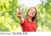Купить «smiling teenage girl in red t-shirt showing peace», фото № 30845439, снято 17 февраля 2019 г. (c) Syda Productions / Фотобанк Лори