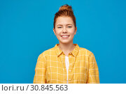 Купить «smiling red haired teenage girl in checkered shirt», фото № 30845563, снято 28 февраля 2019 г. (c) Syda Productions / Фотобанк Лори