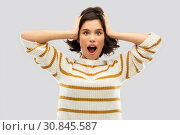 Купить «impressed woman in pullover holding to her head», фото № 30845587, снято 6 марта 2019 г. (c) Syda Productions / Фотобанк Лори