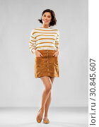 Купить «young woman in striped pullover, skirt and shoes», фото № 30845607, снято 6 марта 2019 г. (c) Syda Productions / Фотобанк Лори