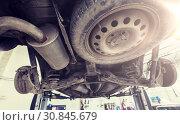 Купить «car on lift at repair station», фото № 30845679, снято 1 июля 2016 г. (c) Syda Productions / Фотобанк Лори