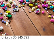 Купить «chocolate eggs and candy drops on wooden table», фото № 30845795, снято 22 марта 2018 г. (c) Syda Productions / Фотобанк Лори