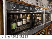 Купить «close up of wine bottles in dispenser at bar», фото № 30845823, снято 25 июня 2018 г. (c) Syda Productions / Фотобанк Лори