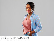 Купить «happy african american woman over grey background», фото № 30845859, снято 2 марта 2019 г. (c) Syda Productions / Фотобанк Лори