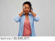 african american woman closing ears by hands. Стоковое фото, фотограф Syda Productions / Фотобанк Лори