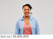 Купить «african woman in headphones listening to music», фото № 30845899, снято 2 марта 2019 г. (c) Syda Productions / Фотобанк Лори