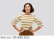 Купить «smiling woman in pullover with hands on hips», фото № 30845923, снято 6 марта 2019 г. (c) Syda Productions / Фотобанк Лори