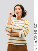 Купить «woman in striped pullover pointing her finger up», фото № 30845927, снято 6 марта 2019 г. (c) Syda Productions / Фотобанк Лори