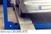 Купить «car on lift at repair station», фото № 30845975, снято 1 июля 2016 г. (c) Syda Productions / Фотобанк Лори