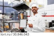 Купить «happy indian chef with tablet pc over kebab shop», фото № 30846043, снято 12 января 2019 г. (c) Syda Productions / Фотобанк Лори