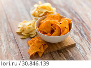 Купить «close up of potato crisps and nachos in bowls», фото № 30846139, снято 22 мая 2015 г. (c) Syda Productions / Фотобанк Лори