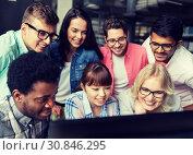 Купить «international students with computers at library», фото № 30846295, снято 19 июня 2016 г. (c) Syda Productions / Фотобанк Лори