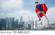 Купить «man in red superhero cape flying in air over city», фото № 30846823, снято 3 февраля 2019 г. (c) Syda Productions / Фотобанк Лори