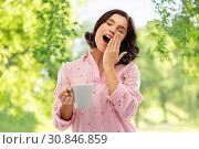 Купить «happy yawning young woman in pajama with coffee», фото № 30846859, снято 6 марта 2019 г. (c) Syda Productions / Фотобанк Лори