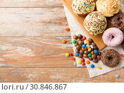 Купить «close up of glazed donuts, candies and cupcakes», фото № 30846867, снято 21 мая 2015 г. (c) Syda Productions / Фотобанк Лори