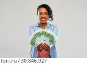 Купить «happy african american woman holding euro money», фото № 30846927, снято 2 марта 2019 г. (c) Syda Productions / Фотобанк Лори