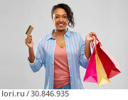 Купить «african american woman shopping with credit card», фото № 30846935, снято 2 марта 2019 г. (c) Syda Productions / Фотобанк Лори