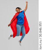 Купить «happy african american woman in superhero red cape», фото № 30846951, снято 2 марта 2019 г. (c) Syda Productions / Фотобанк Лори