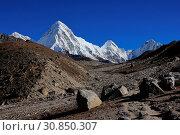 Купить «Mountain landscape in the Everest National Park, Nepal. Majestic mount Pumori. Path leading towards the Everest base camp.», фото № 30850307, снято 4 июля 2020 г. (c) age Fotostock / Фотобанк Лори