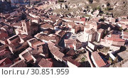 Купить «Aerial view of tiled roofs and old streets of Daroca, Spain», видеоролик № 30851959, снято 10 марта 2019 г. (c) Яков Филимонов / Фотобанк Лори