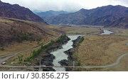 Купить «Aerial video from drone with flight over Oroktoi bridge along Altai river Katun», видеоролик № 30856275, снято 26 мая 2019 г. (c) Serg Zastavkin / Фотобанк Лори