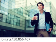 Купить «Professional man in jacket walking with coffee», фото № 30856467, снято 20 апреля 2017 г. (c) Яков Филимонов / Фотобанк Лори