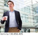 Купить «Professional man in jacket with coffee», фото № 30856495, снято 20 апреля 2017 г. (c) Яков Филимонов / Фотобанк Лори