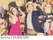 Купить «friendly young female and man choosing hats in the store», фото № 30856539, снято 2 мая 2017 г. (c) Яков Филимонов / Фотобанк Лори