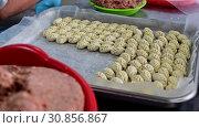 Купить «Pelmeni making process factory handmade», видеоролик № 30856867, снято 2 июня 2019 г. (c) Mark Agnor / Фотобанк Лори